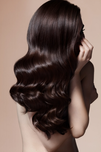 Black wavy shiny hair beige background - new york hair photographer